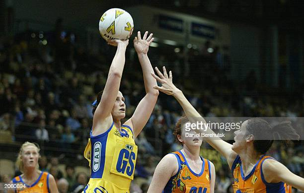 Jane Altschwager of the Swifts in action during the Commonwealth Bank Trophy netball match between the Sydney TAB Swifts and the Melbourne Kestrels...