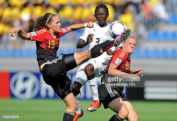 Jane Ayieyam of Ghana challenges for the ball with Franziska Jaser and Lena Lueckel of Germany during the FIFA U17 Women's World Cup 2012 group D...