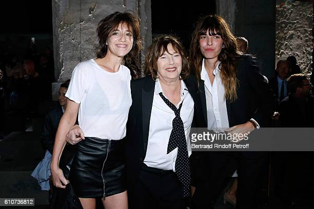 Jane Birkin standing between her daughters Charlotte Gainsbourg and Lou Doillon attend the Saint Laurent show as part of the Paris Fashion Week...