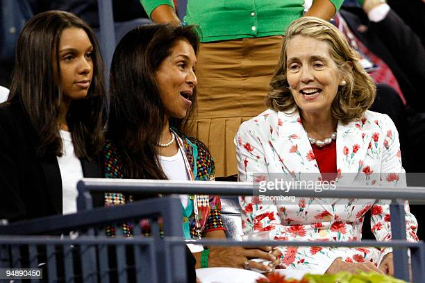 Jane Brown Grimes president of the United States Tennis Association right speaks to Jeanne Moutoussamy Ashe wife of the late former tennis player...