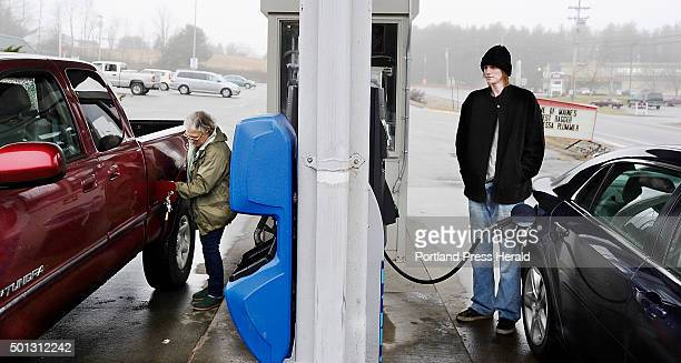 Jane Brown left from Standish and Aaron LeConte from Buxton fill their tanks with gas priced at $199/gallon at the Sunoco Gas Station in Buxton 'Its...
