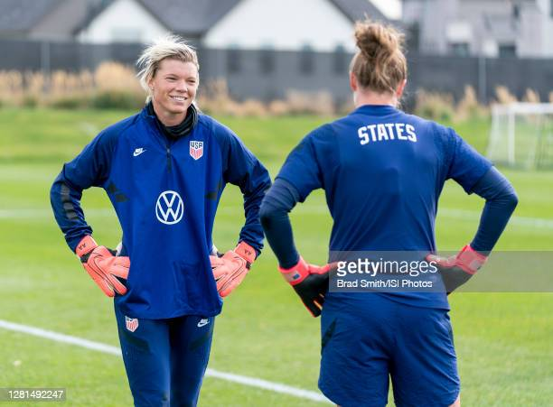 Jane Campbell and Alyssa Naeher of the USWNT talk during a training session at Dick's Sporting Goods Park training fields on October 20 2020 in...