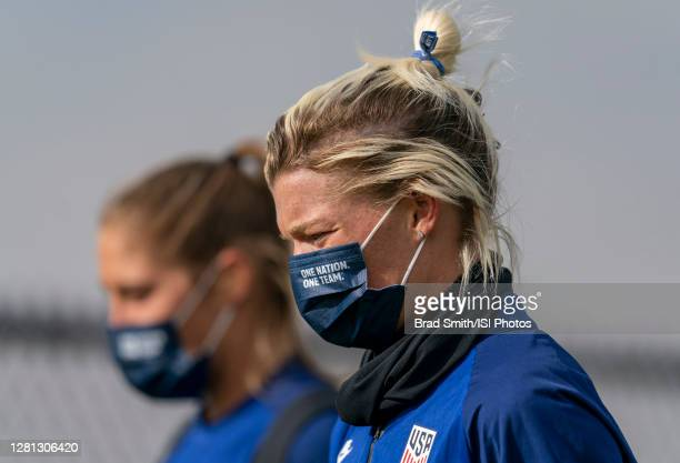 Jane Campbell and Aubrey Bledsoe of the USWNT walks off the field after a training session at Dick's Sporting Goods Park training fields on October...
