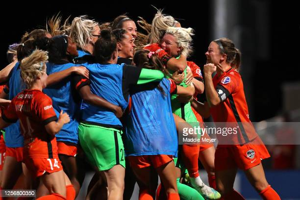 Jane Campbell of Houston Dash celebrates with her teammates after defeating the Utah Royals FC in penalty kicks in the quarterfinal match of the NWSL...
