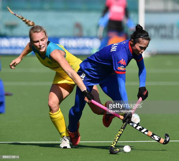 Jane Claxton of Australia and Juliani Din of Malaysia during the FINTRO Women's Hockey World League SemiFinal Pool B game between Australia and...