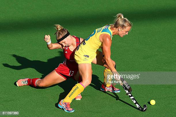 Jane Claxton of Australia and Sarah Robertson of Great Britain contest for the ball during the International Test match between the Australian...
