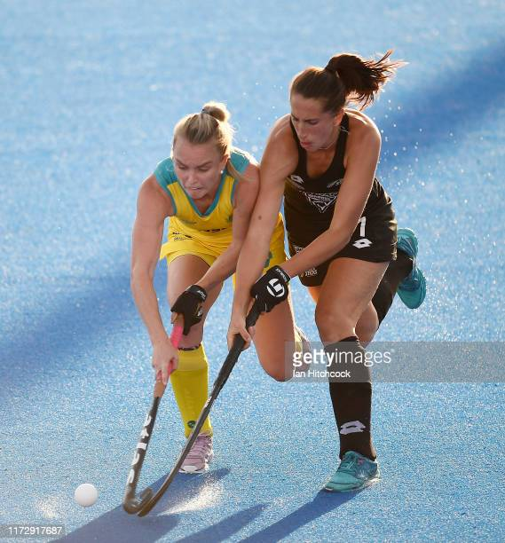 Jane Claxton of Australia contests the ball with Stephanie Dickins of New Zealand during the 2019 Oceania Cup match between the Australian Hockeyroos...