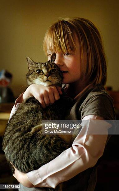 FE10RMALLEYCAT_CM02 Jane Cole's 8yearold daughter Cassidy Cole holds Dora at their Denver home on Wednesday April 2 2008 Jane is a volunteer for...