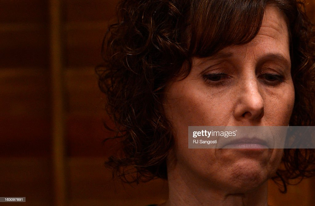 Jane Dougherty speaks to media before testifying to Colorado lawmakers on a universal background check bill for private gun sales, March, 04, 2013, at the Colorado State Capitol. Dougherty's sister, Mary Sherlach, was killed at Sandy Hook.