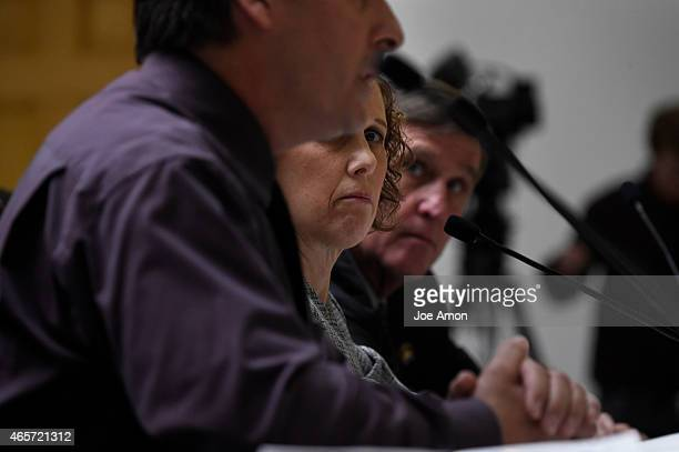 Jane Dougherty who's sister that was killed at the Sandy Hook Elementary School shooting in Newtown Conn watches as Police Sergeant Dave Hoover uncle...
