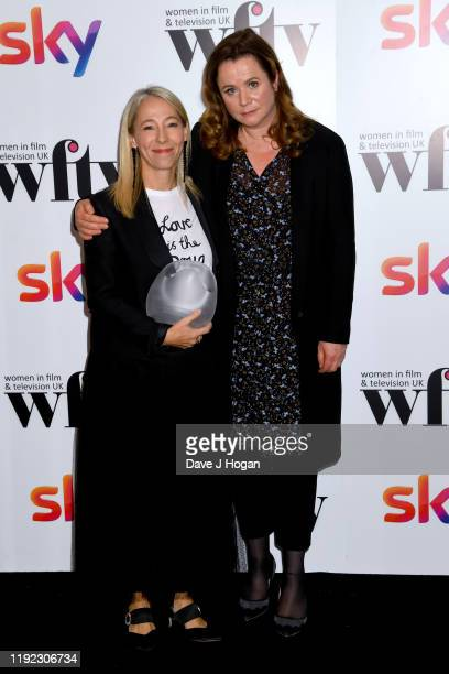 Jane Featherstone winner of the Barclays Business Awards and presenter Emily Watson during Women in Film TV Awards 2019 at Hilton Park Lane on...