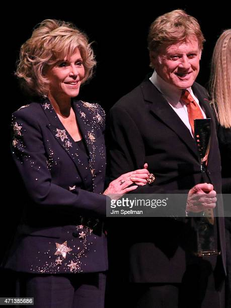 Jane Fonda and honoree Robert Redford speak onstage at 42nd Chaplin Award Gala at Alice Tully Hall Lincoln Center on April 27 2015 in New York City