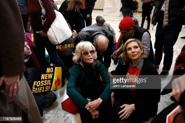 Jane Fonda and June Diane Raphael demonstrate inside the Russell US Senate office building during Fire Drill Friday climate change protest on...