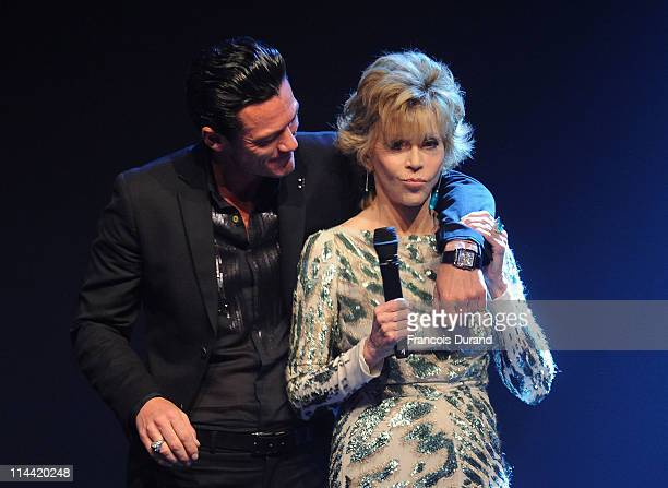 Jane Fonda and Luke Evans onstage at amfAR's Cinema Against AIDS Gala during the 64th Annual Cannes Film Festival at Hotel Du Cap on May 19, 2011 in...