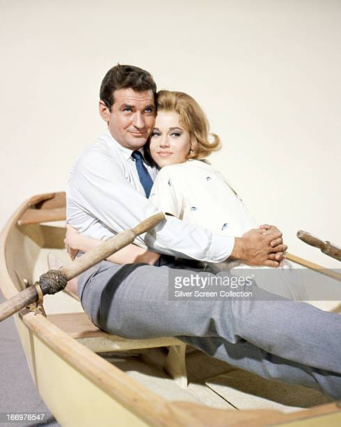 Jane Fonda and Rod Taylor posing in a rowboat in a promotional portrait for 'Sunday in New York', directed by Peter Tewksbury, 1963.