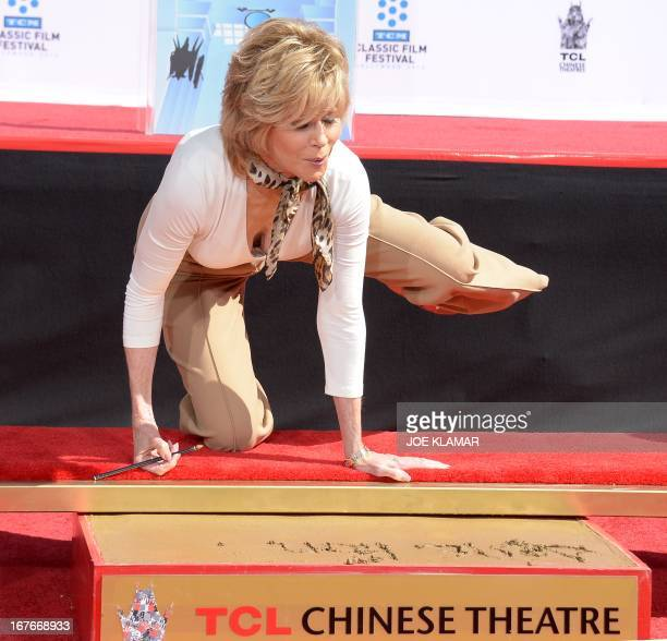 Jane Fonda does aerobic moves during her Handprint/Footprint Ceremony during the 2013 TCM Classic Film Festival at TCL Chinese Theatre on April 27...
