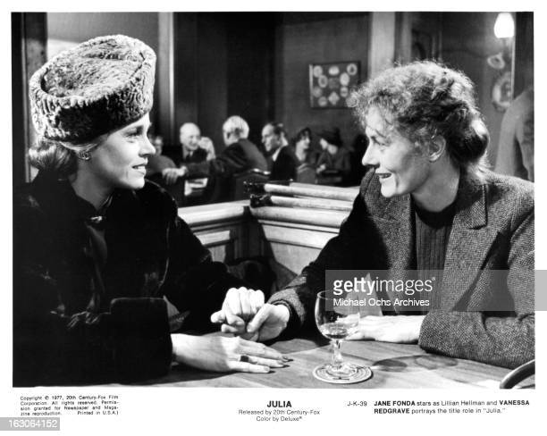 Jane Fonda has a drink with Vanessa Redgrave in a scene from the film 'Julia' 1977