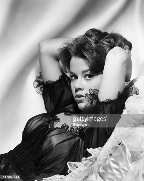 Jane Fonda in a sultry pose for a publicity portrait She wears sheer clothing and holds her hands up behind her head Ca 19601970
