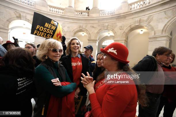 """Jane Fonda, June Diane Raphael and Abigail Disney demonstrate inside the Russell US Senate office building during """"Fire Drill Friday"""" climate change..."""