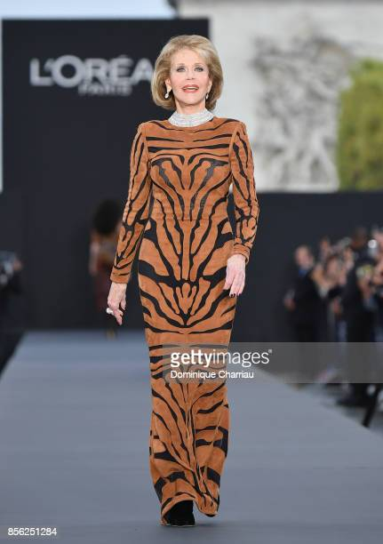 Jane Fonda walks the runway during the Le Defile L'Oreal Paris show as part of the Paris Fashion Week Womenswear Spring/Summer 2018 on October 1,...
