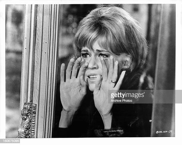 Jane Fonda watches in horror and shock over engagement party in a scene from the film 'The Game Is Over' 1966