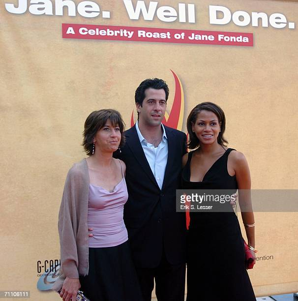 Jane Fonda's children Vanessa Vadim and Troy Garity and Garity's friend pose for a picture as they participate in Jane Well Done A Celebrity Roast of...
