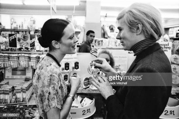 Jane Forth and Andy Warhol shopping for cosmetics 1970