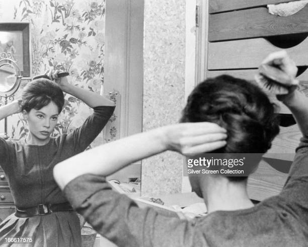Jane Fosset played by French actress Leslie Caron brushes her hair in front of a mirror in a scene from 'The LShaped Room' directed by Bryan Forbes...