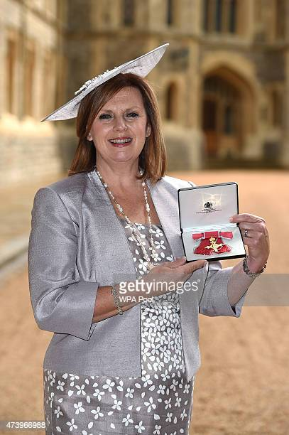 Jane Gates with her OBE for services to seriously ill children and their families in the South East at an investiture ceremony at Windsor Castle May...