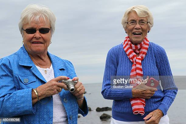 Jane Gleason of Yarmouth Mass left and Jean Perkins right of Kennebunkport ME watch former President George H W Bush land after making his eighth...