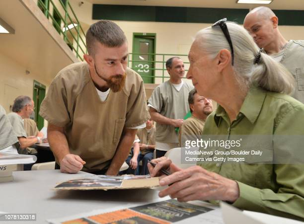 Jane Goodall chats with inmate Kelley Wiggins who was inspired by Goodall's Roots and Shoots program to begin creative writing Wiggins has passed on...