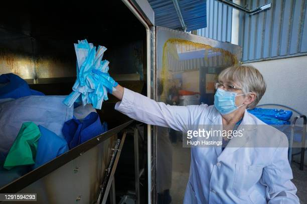 Jane Ham, Production Controller, adds used clinical materials including face masks into the new waste recycling unit at the Royal Cornwall Hospital,...