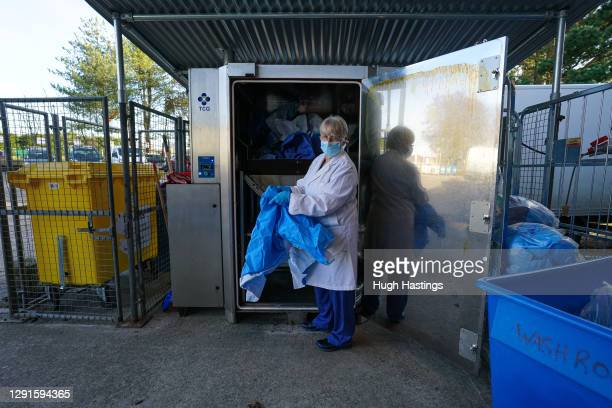 """Jane Ham, Production Controller, poses for the photographer in front of the hospital""""u2019s new recycling unit at the Royal Cornwall Hospital, on 15..."""