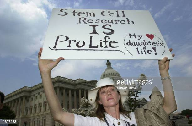 Jane Harman holds a sign in support of stem cell research July 17 2001 at a press conference outside the Capitol building in Washington DC Harman''s...