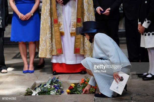 Jane Hawking places flowers at the site of the internment of the ashes of British scientist Stephen Hawking in the nave of Westminster Abbey on June...
