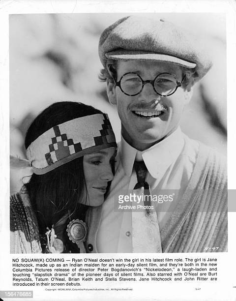 Jane Hitchcock leans on Ryan O'Neal in a publicity portrait for the film 'Nickelodeon' 1976