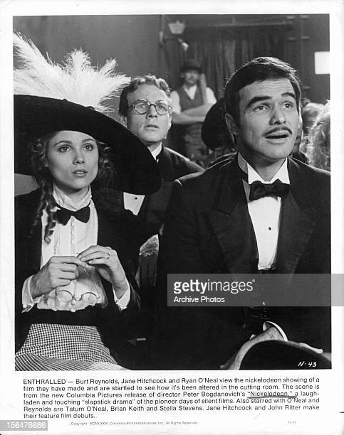 Jane Hitchcock Ryan O'Neal and Burt Reynolds watch their film in a scene from the film 'Nickelodeon' 1976