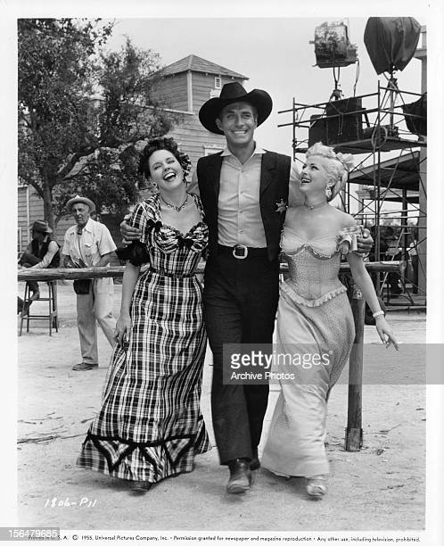 Jane Howard Jock Mahoney and Mara Corday pose in publicity portrait for the film 'A Day Of Fury' 1956