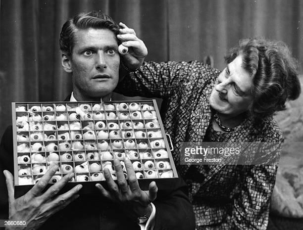 Jane Jackson an employee of Madame Tussaud's London selecting a matching eye for disc jockey Pete Murray's waxwork model