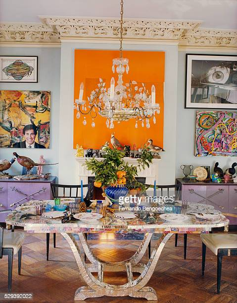 jane kaplowitz at home: multicolored patterned dining table - fernando bengoechea stock pictures, royalty-free photos & images