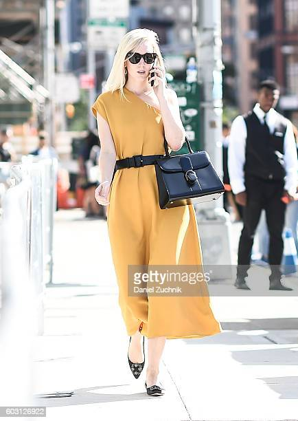Jane Keltner de Valle is seen wearing a yellow dress with a black bag outside the J Crew show during New York Fashion Week Spring 2017 on September...