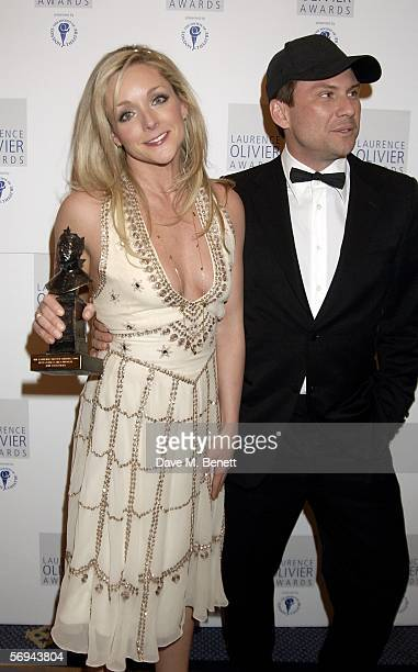 Jane Krakowski and Christian Slater pose in the Awards Room with the award for Best Actress in Musical for Guys and Dolls at the Laurence Olivier...