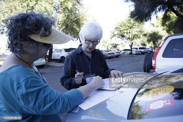Jane Lassar and Susan Bickel of MoveOn prepare to canvass for Ann Kirkpatrick on November 3 2018 in Tucson Arizona