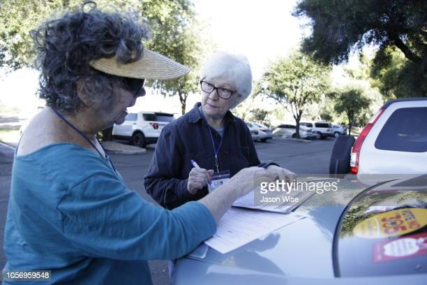 Jane Lassar and Susan Bickel of MoveOn prepare to canvass for Ann Kirkpatrick on November 3 2018 in Tucson Arizona