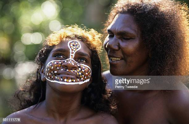 Jane Leti her face painted with her clan totems with her mother near Ramingining Arnhem Land Painted by he father to make her feel strong and happy