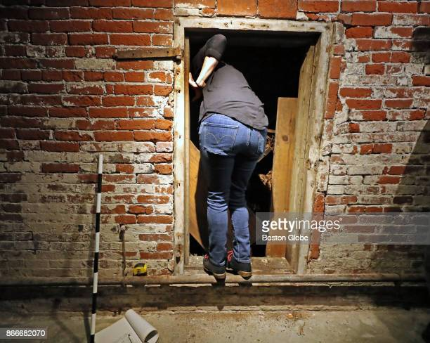 Jane Lyden Rousseou a funerary archaeologist looks into a justopened 200yearold tomb beneath the Old North Church in Boston on Oct 24 2017 After...