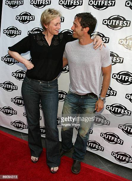 Jane Lynch and Brad Falchuk arrive to the 27th Annual Los Angeles Gay Lesbian Film Festival screening of 'Glee' held at the Director's Guild of...