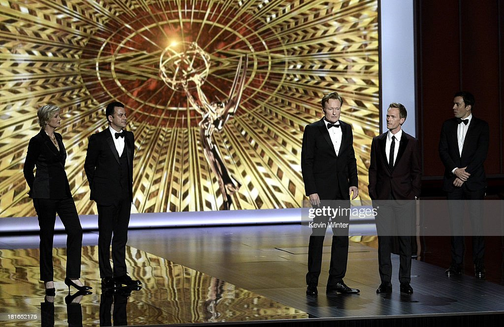 Jane Lynch, Jimmy Kimmel,Conan O'Brien, Jimmy Fallon and host Neil Patrick Harris onstage during the 65th Annual Primetime Emmy Awards held at Nokia Theatre L.A. Live on September 22, 2013 in Los Angeles, California.