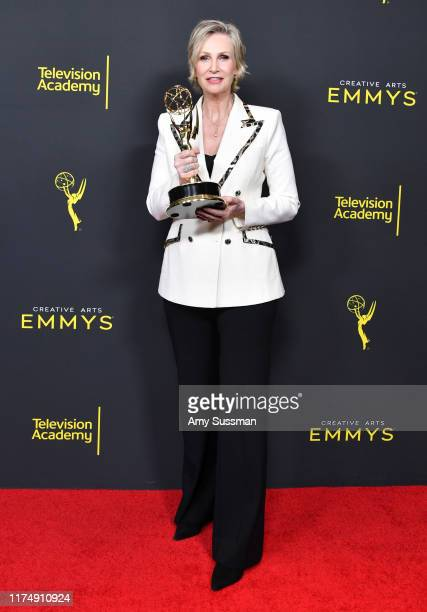 Jane Lynch poses with the Outstanding Guest Actress In A Comedy Series Award for 'The Marvelous Mrs. Maisel' in the press room during the 2019...