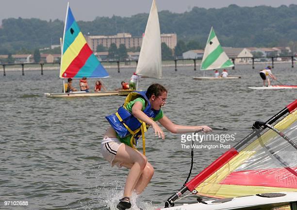 7/31/2006 ARLINGTON VA Jane Mahoney of Potomac Md succumbs to the cool water of the Potomac River at the Washington Sailing Marina Sailing Camp in...